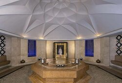 Interior view of Moroccan hammam room in spa with guest