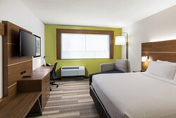 Rest comfortably in rooms with king-size bed, work desk, & TV.
