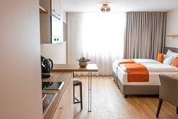 Zeitgemäße Apartments mit Kitchenette & modernem Bad