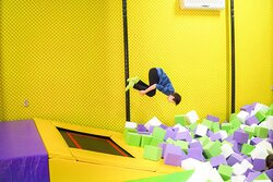 Jumping from the elastic trampolines into the foam pit