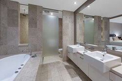 Interior view of bathroom in One Bedroom Family Room with bathtub and double vanity