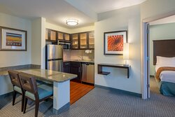 """Stay """"home"""" and cook in our in-suite kitchen with a cooktop."""