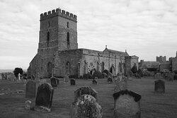 Bamburgh, Northumberland, England, United Kingdom, St Aidan's Church - view at massive tower.