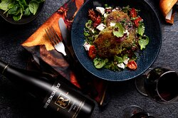 H E R B E D C R U S T E D A U B E R G I N E S T E A K S Chunky aubergine steaks on a bed of goats cheese, confit tomato and lentils with red wine vinaigrette.