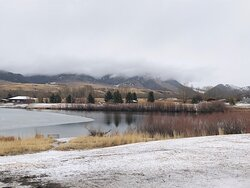 View of the lake & snow covered mountain range