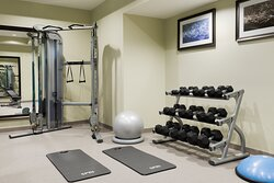 Our fitness center features cardio machines, free weights & more.