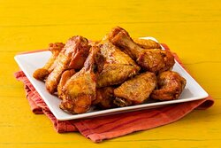 12 Chicken Wings- 6 wings and 6 drumsticks with your choose of sauce on the side.
