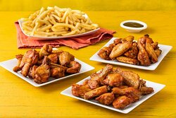 50 Chicken Wings with 5 French Fries- Twenty Five (25) wings and Twenty Five (25) drumsticks, served with your choice of Dipping Sauce and Five (5) Orders of French Fries.