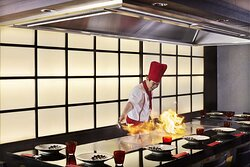 Chef cooking with flames at the Benihana