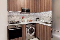 Studio kitchen with oven and washing machine