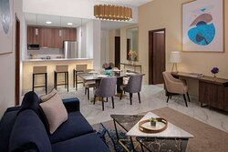 Superior Two Bedroom Apartment lounge, dining area and kitchen with bar