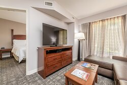 Spacious corporate housing with separate living and sleeping areas