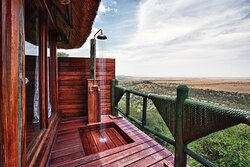 Outdoor rain shower in Luxury Safari Room at Mbali Mbali Soroi Serengeti Lodge