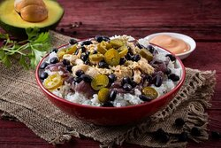 Chipotle Pollo Burrito Bowl- Mexican burrito bowl with roasted chicken, black beans, caramelized onions, and pickled jalapenos. Chipotle aioli sauce is served on the side.