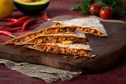 Beef Cheddar Melt Quesadilla- Quesadilla with Cheddar Cheese and Ground Beef. Served in a toasted wheat wrap.