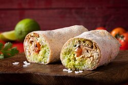 Classic Mexican Chicken Burrito- Mexican burrito with shredded chicken, cheddar cheese, guacamole, and roasted tomato salsa. Served with white rice in a wheat wrap.