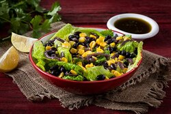 Mexican Side Salad- Romaine Lettuce with Black Beans, Seasoned Corn, Caramelized Onion and Chimichurri Lime Dressing on the Side.