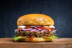 Classic Gorilla Burger- Beef Patty with your Choice of Free Toppings and Sauce, served on a Toasted Potato Bun.