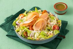 Turkey Caesar Delight Salad (Paleo)- Paleo Salad with Romaine Lettuce, Turkey Ham, Parmesan Cheese, Cherry Tomatoes, Chickpeas, and Red Onions with your Choice of Dressing (served on the side).