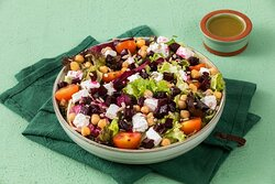 Greek Light Salad (Vegetarian)- Vegetarian Salad with Mixed Greens, Feta Cheese, Cherry Tomatoes, Chickpeas, Roasted Beets, and Sunflower Seeds with your Choice of Dressing (served on the side).