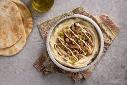 DIY Hummus Bowl- Create your own Hummus Bowl with Free Protein and Toppings, served with Pita bread on the side.
