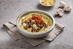 Pesto Crunch Hummus Bowl- Parsley Pesto Hummus Bowl with Roasted Mushrooms, Roasted Cherry Tomato, Grana Padano and Crunchy Onion with Pita Bread Served on the Side.