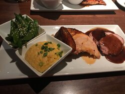 Zea Rotisserie 03 30 21, Rotisserie Sampler with chicken & Tender pork roast with roasted corn grits and Thai snap beans