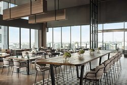 Greenhouse Restaurant & Terrace dining area with panoramic city views