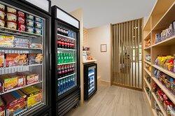 Guest market  frozen food, snacks , beverages sundries,beer,wine