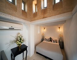 A charming mini suite brimming with character. The sleeping area features a spectacular dome (kouba in arabic) from which the room takes its name. Down a short flight of stairs is a cosy sitting area with satellite TV leading to the compact shower room.
