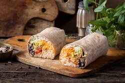 Holy Guacamole Wrap- Wheat wrap with white rice, black beans, guacamole, sautéed peppers and onions, roasted tomato salsa, and almond habanero mash.