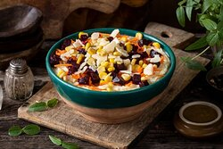 Atlas Mash- Mashed potato bowl with parmesan cheese, seasoned corn, shredded carrots, and roasted red beets. Balsamic vinaigrette dressing is served on the side. Toppings are served chilled over warm mashed potatoes.