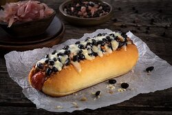 Bull Dog Hotdog- Beef hot dog with ground beef, cheddar cheese, black beans, and Brooklyn BBQ Sauce. Served on a toasted potato bun.