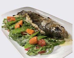 Levrek Izgara……  Mediterranean sea bass , arugula &tomato concase, snow peas, carrots, asparagus & sauce ravigote
