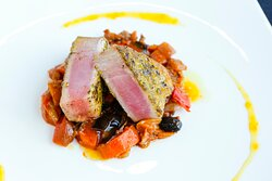 Tuna crusted with pistachios, served with Sicilian caponata and orange coulis