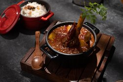 Mutton shank railway curry   Our version of the classical dish from the bygone era, this lamb shanks  and potatoes are broiled and stewed in a spiced yogurt gravy |  steamed basmati rice
