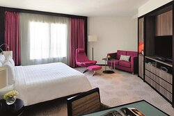King Bed and purple theme decor in Avani Superior Room at Avani Deira Dubai