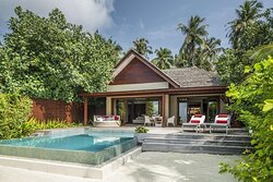 The exterior of a Family Beach Pool Villa with pool in the foreground.