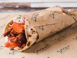 Tortilla wrap Gyros... slices of pork chops (200gr gyros, tomato, onion, yogurt sauce)