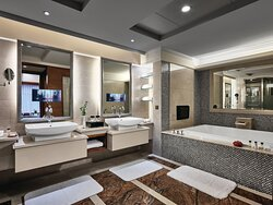 Spacious bathroom with twin washtable and double-ended bathtub