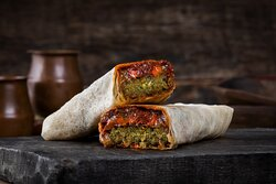 Fancy Falafel Saj- Falafel saj with Caramelized Onions, Roasted Peppers, and Sun Dried Tomato Tapenade. Wrapped in Saj.