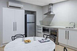 Interior view of kitchen and dining area in Two Bedroom Premier Suite