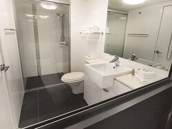 Interior view of bathroom in City Scape with shower