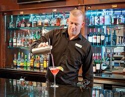 Enjoy a drink in WingTips Bar