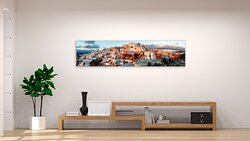 The village of Oia Santorini displayed in Oria Art Gallery. Come and see the beautiful art overlooking the Santorini caldera at this special Oia Santorini art gallery.