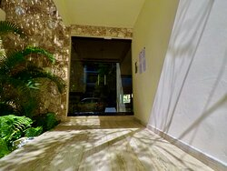 Main Entry at Paramar Jade in Aldea Zama Tulum where We can take You back & forward for your airport transfers.
