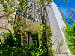 Front of Paramar Jade in Aldea Zama Tulum where We offer You our airport transfers and Hotel-Hotel transfers.