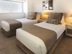 Interior view of bedroom in Three Bedroom Suite with twin beds