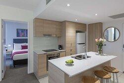 AVANI-Broadbeach-Bedroom-Ocean-Suite-Kitchen