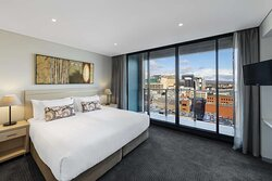 Interior view of bedroom in Two Bedroom Deluxe Suite with city view